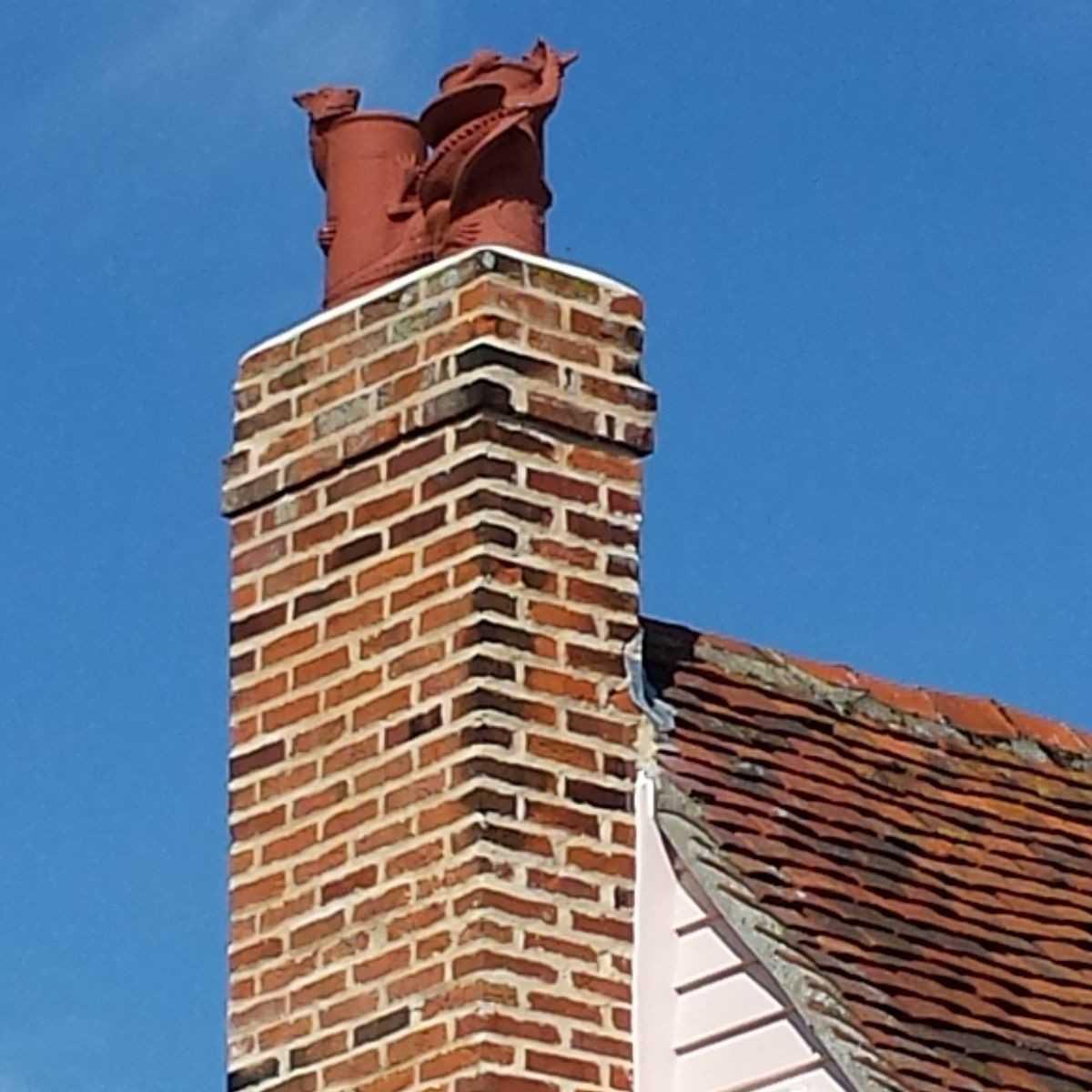 just landed dragon chimney pot - terracotta
